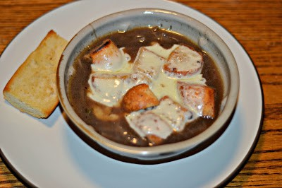 Hearty and delicious French Onion Soup with homemade croutons and cheese.