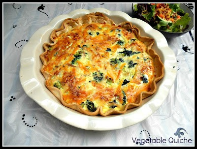 Farm Fresh Vegetable Quiche made with fresh vegetables, farm fresh eggs, and cheese.