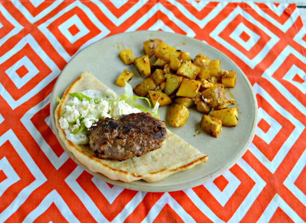 Lamb burger in a pita with a side of Greek potatoes