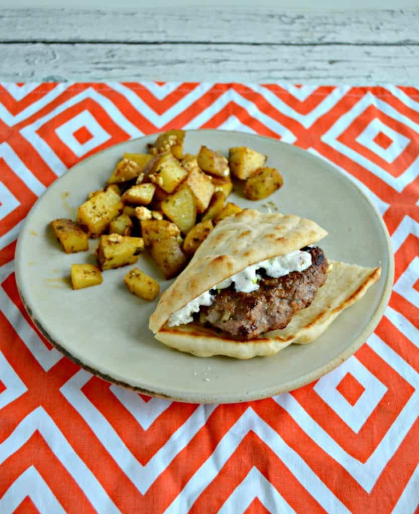 Lamb burger folded inside a pita with Greek potatoes on a plate