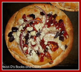 Greek Pita Pizzas topped with hummus, feta cheese, and topping!