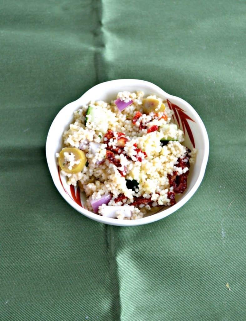 A white bowl of Greek Couscous