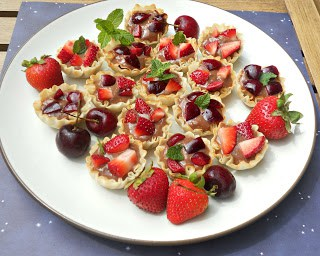 Fruit Tarts with Nutella Pastry Cream and red berries