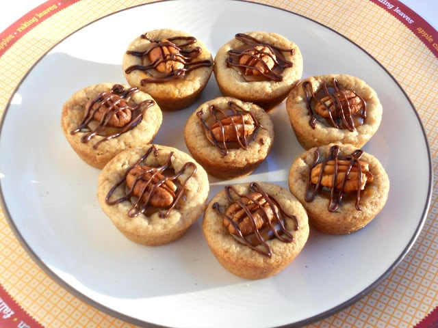 Sugar cookie cups filled with caramel, chocolate, and pecans.