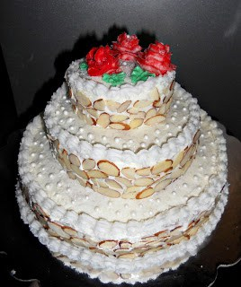 Three Tiered Wedding Cake with almonds, Nutella, vanill, chocolate, and buttercream.