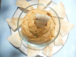 Roasted Red Pepper Hummus is a delicious appetizer.