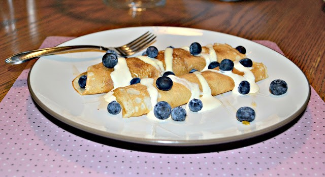 Crepes filled with homemade peach jam and topped with blueberries from Hezzi-D's Books and Cooks