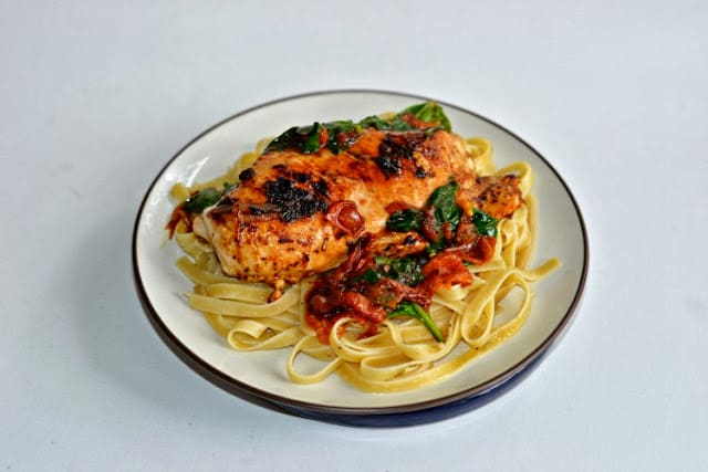 Quick and easy Italian Herb Sauteed Chicken Breasts over pasta