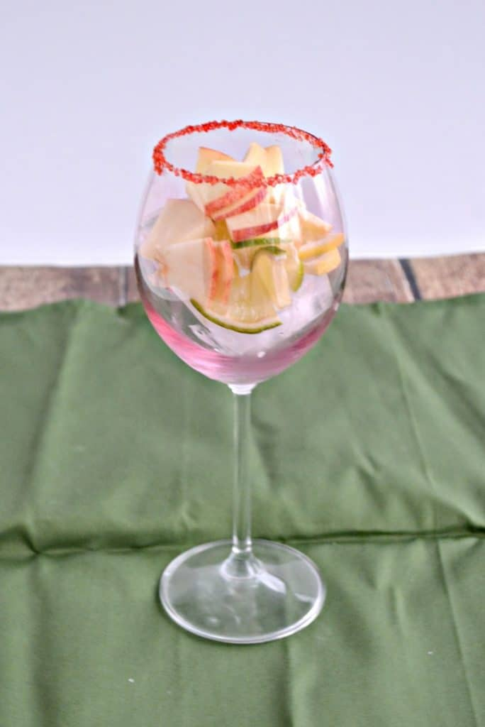 Mix fruit in a glass for Apple Sangria