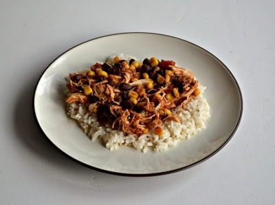 Slow Cooker Southwest Chicken with corn, black beans, tomatoes, and spices.