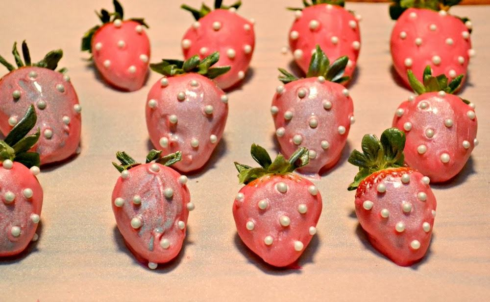 Chocolate covered strawberries dipped in pink chocolate and sprayed with silver edible paint