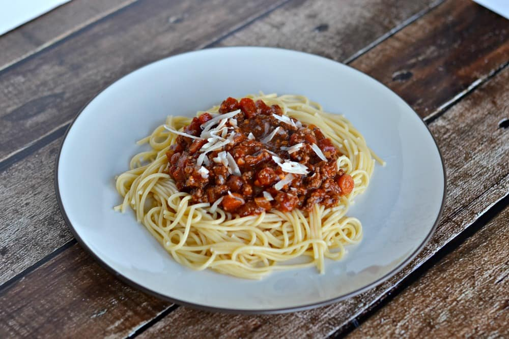 Bolognese Sauce is made with red wine, ground beef, and fresh vegetables.  https://www.hezzi-dsbooksandcooks.com