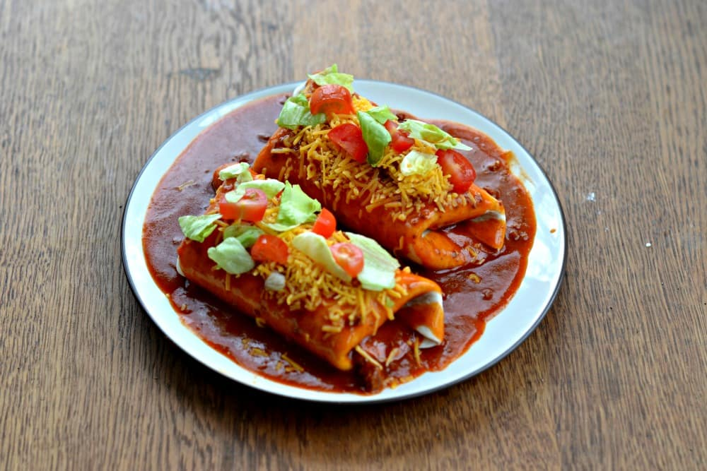 Wet Burritos stuffed with chicken and topped with homemade sauce.