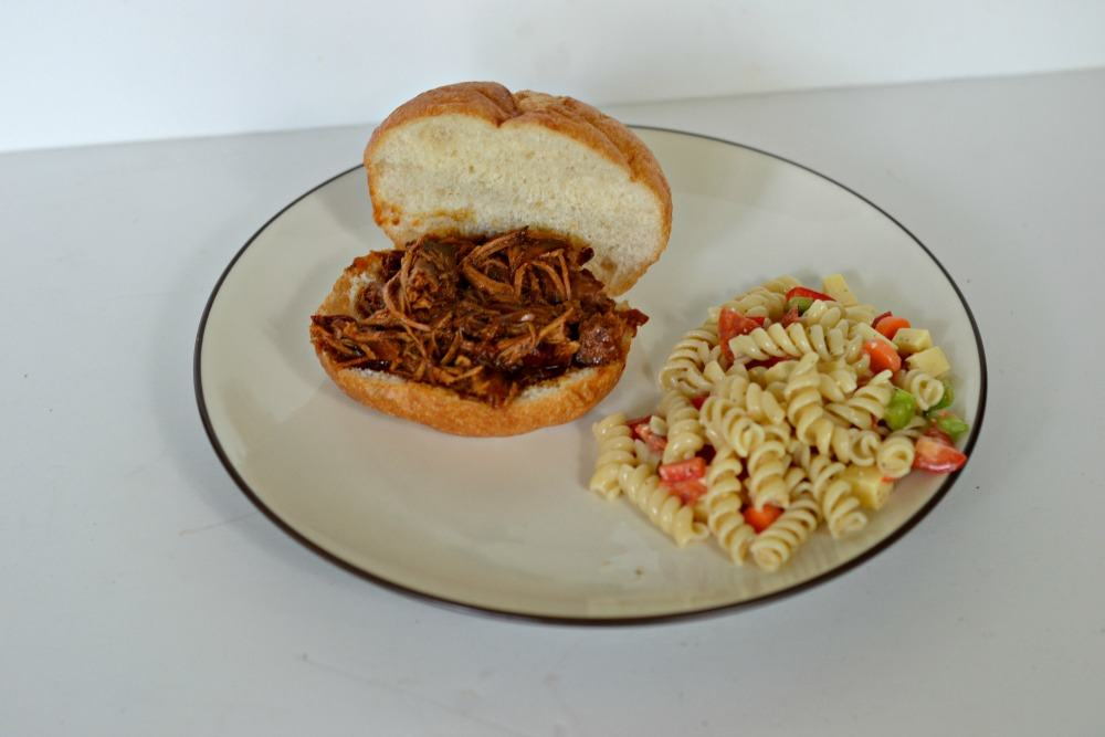 Dr. Spicy BBQ pulled pork sandwiches are made in the crock-pot so you don't have to turn on the oven!