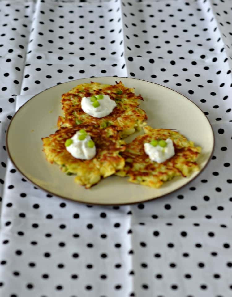 Kohlrabi fritters are pan fried and then topped with a yogurt sauce