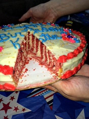 Stripes of red velvet cake and vanilla cake inside a birthday cake!