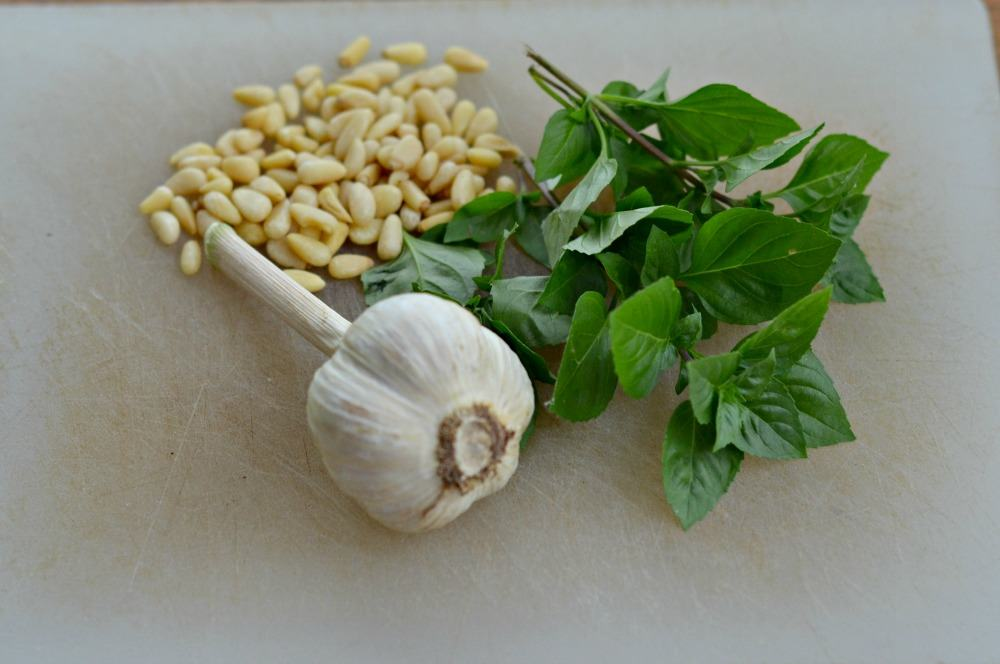 Getting ready to make pesto with basil from the garden, garlic from my CSA, and pine nuts