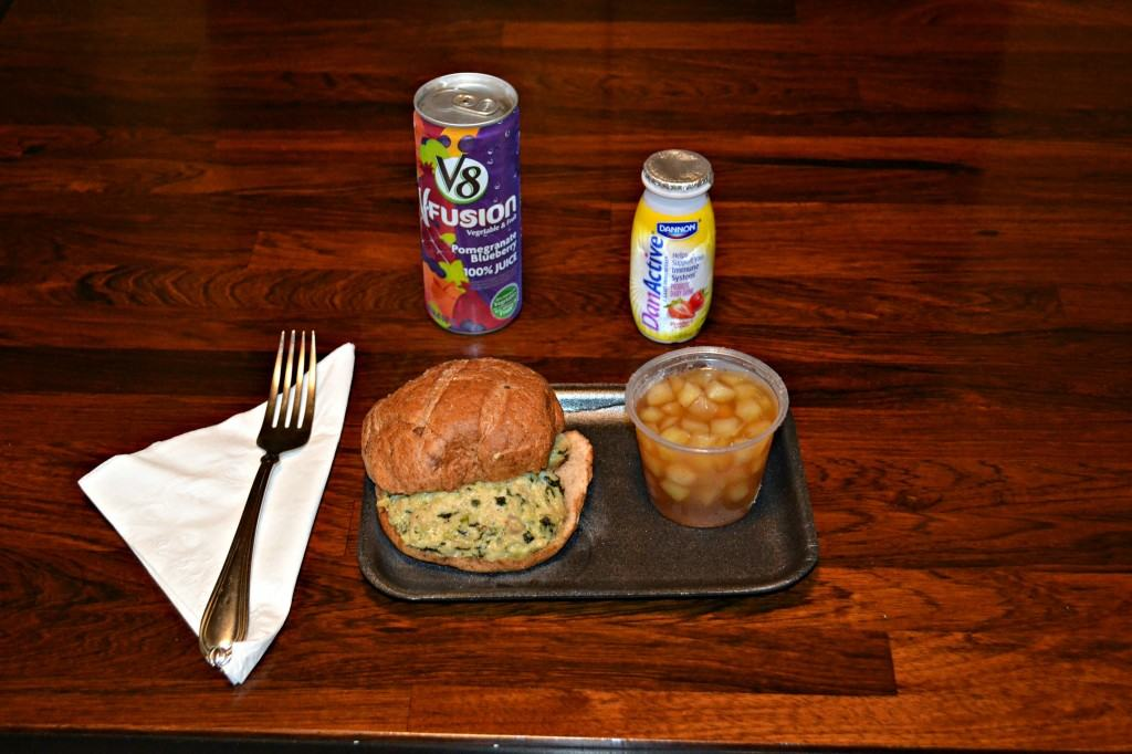 Diet-to-go Lunch of Chicken Florentine Sandwich, apple jello, V8 Fusion, and a yogurt drink