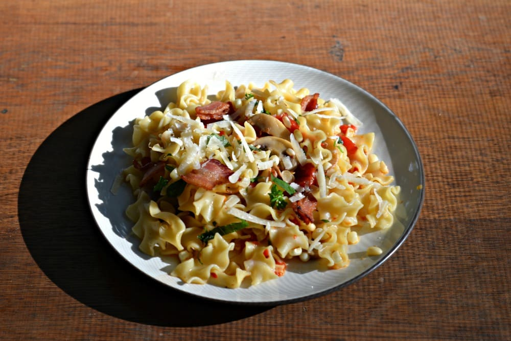 Pasta with mushrooms, bacon, and corn