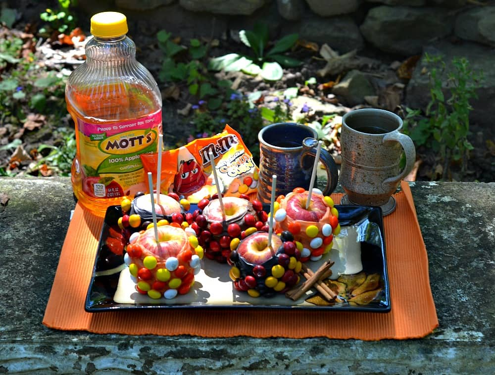 Host a fall party with Chocolate DIpped M&M's covered apples and Hot Mott's Apple Cider