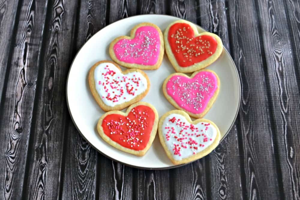 Heart shaped sugar cookies with icing and sprinkles!