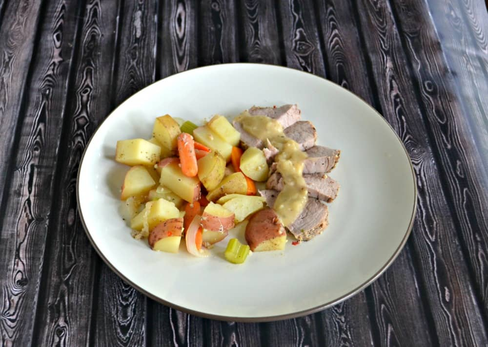 Delicious Roasted Peppercorn and Garlic Pork Loin with Potatoes and Vegetables