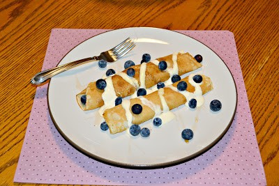 Delicate crepes stuffed with Homemade Peach Jam and topped with blueberries