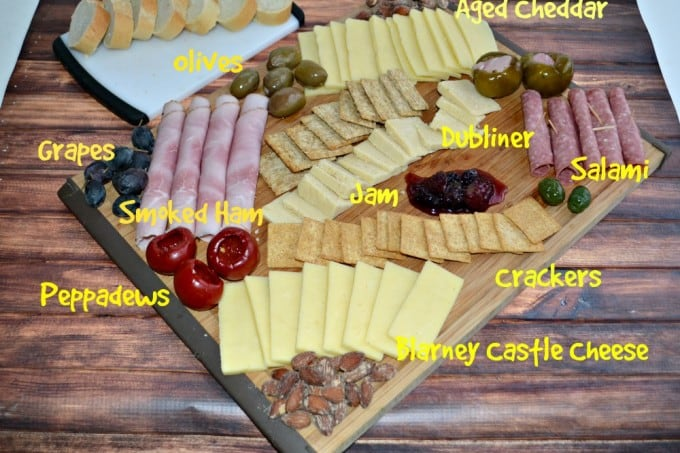 Holiday Charcuterie Platter with cured meats, cheeses, fruits, nuts, and more!