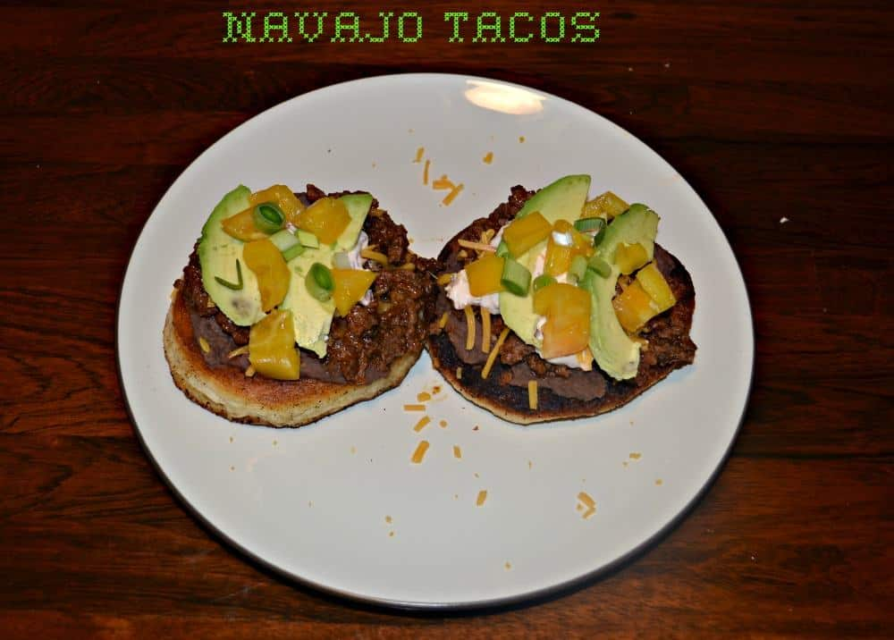 Navajo Tacos with ground beef, cheese, and vegetables on crispy bread