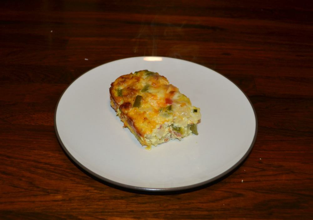 Delicious hot Breakfast Casserole with Sausage, cheese, eggs, and vegetables