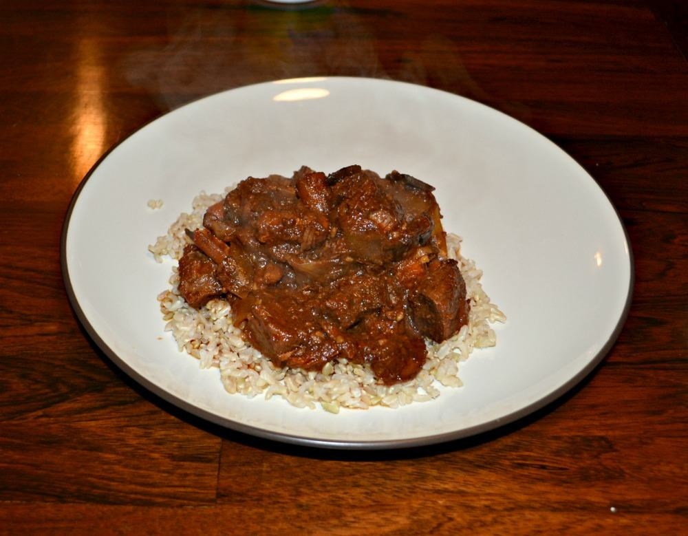 Delicious and tender Beef Marsala Stew served over rice