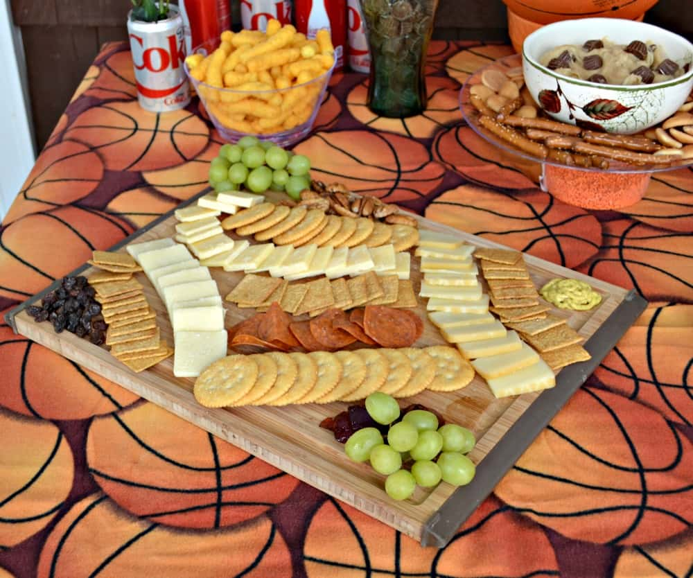 Basketball Party with a gourmet cheese board, chips, and Coke
