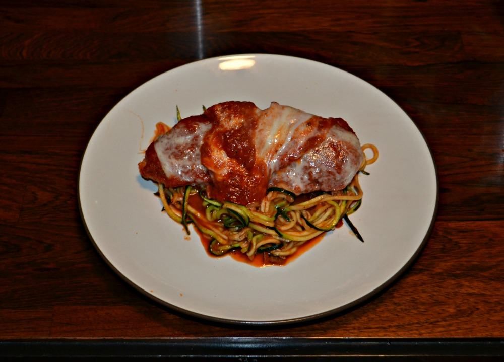 Go light for dinner tonight!  Baked Chicken Parmesan over Zoodles is delicious and lighter then the original version.
