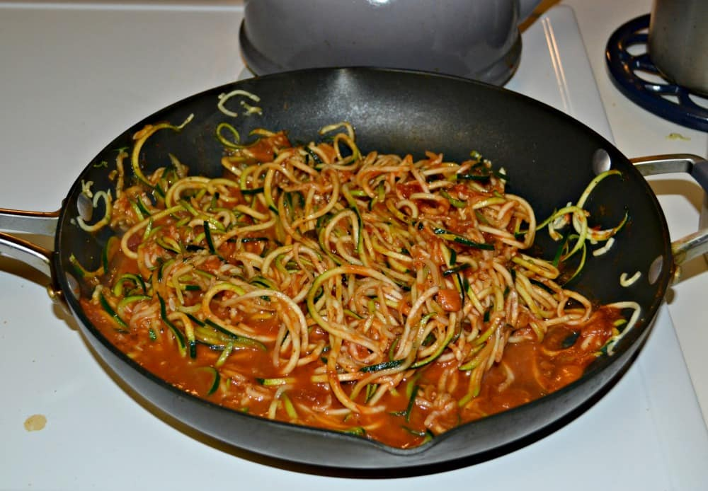 Zoodles mixed with pasta sauce is a healthy substitute for pasta marinara.