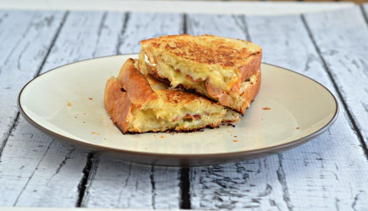 Jalapeno Popper Grilled Cheese Sandwiches are a delicious way to celebrate National Grilled Cheese Day!