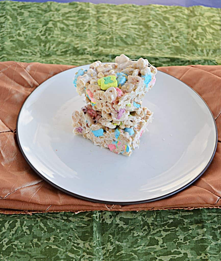 A top view of a stack of Lucky Charms Treats on a plate.