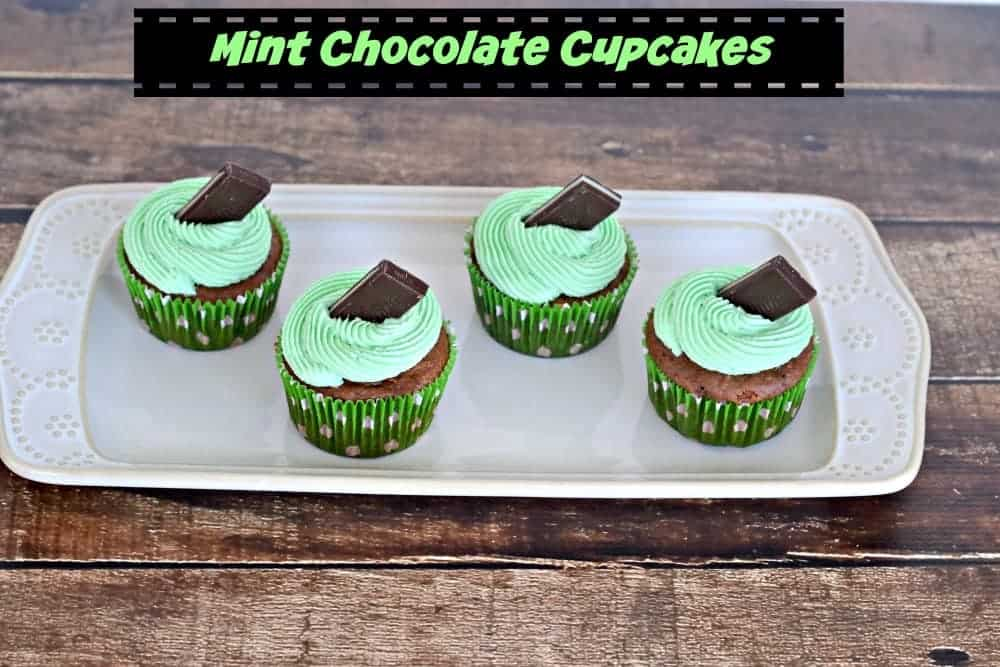 Chocolate Cupcakes with Green Mint Frosting topped with a chocolate mint!