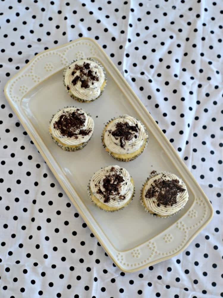 OREO cookie cupcakes topped with vanilla frosting and sprinkled with Oreos.