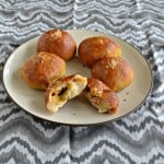 Pretzel Buns filled with spicy chorizo and cheddar cheese. A great appetizer or snack recipe!