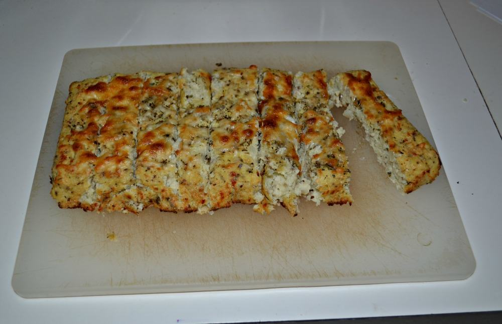 Tasty Cauliflower Breadsticks are topped off with herbs and cheese