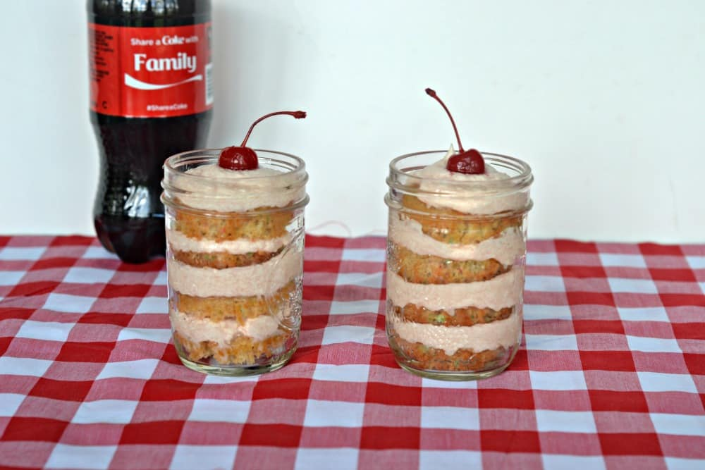 Coke Float Cupcakes in a Jar layers Coke Cupcakes with Cherry Vanilla Frosting and puts a cherry on top