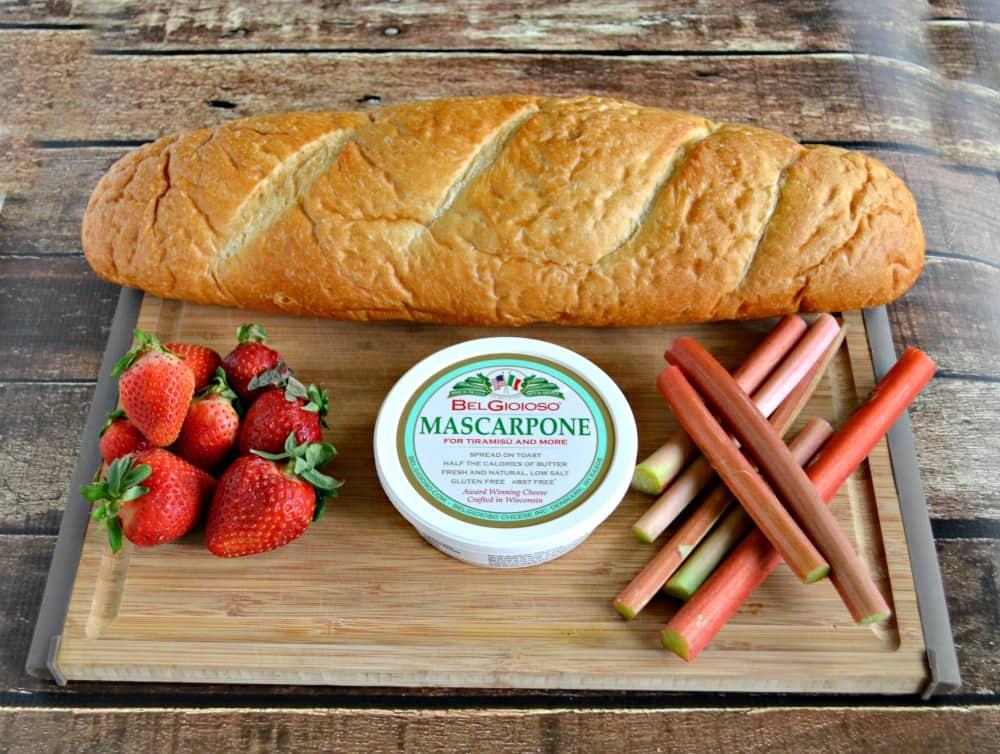 Crusty bread, rich Mascarpone cheese, tart rhubarb, and sweet strawberries make an awesome crostini recipe.