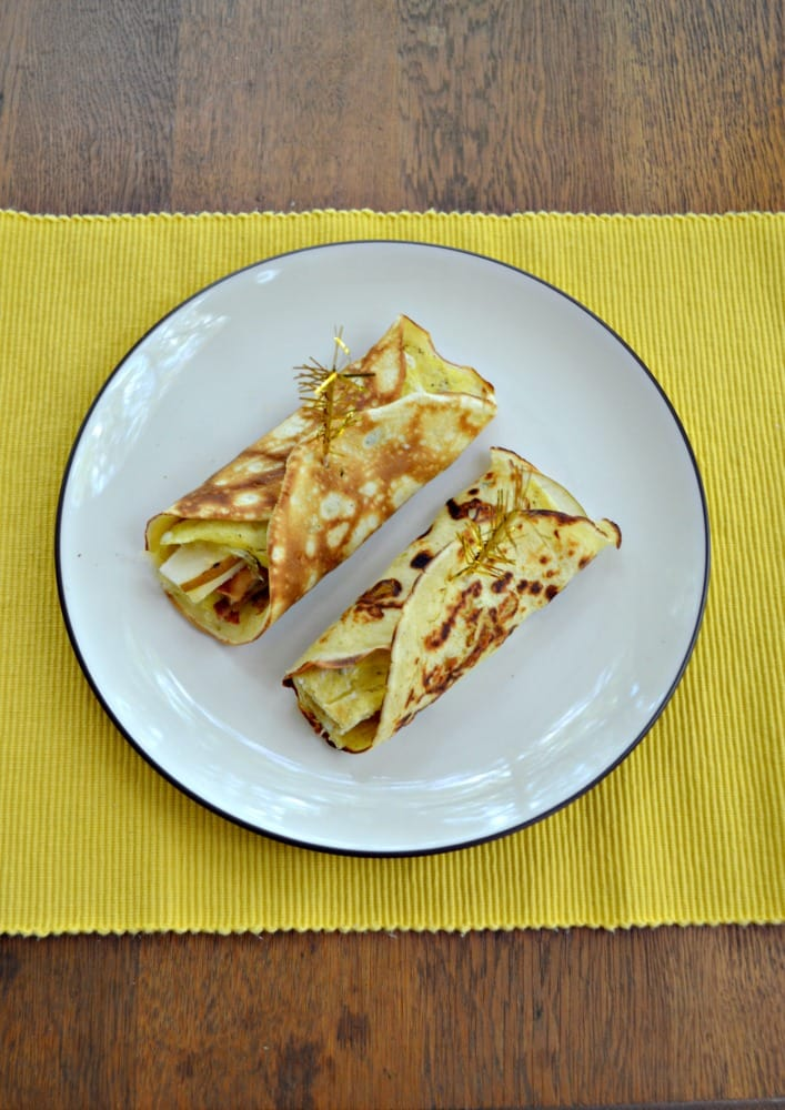 Savory Breakfast Crepes are filling with an omelet of eggs, bacon, pears, and sweet Skellig cheese.