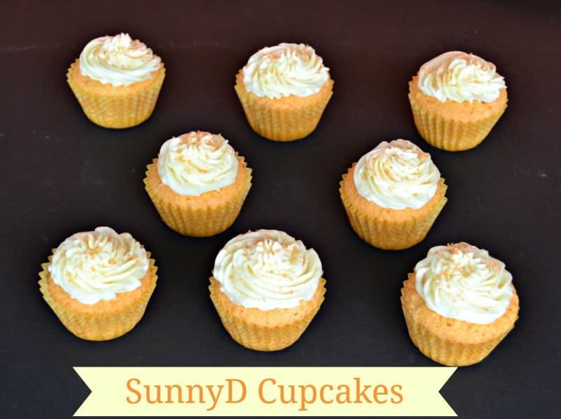 SunnyD Cupcakes are orange flavored cupcakes topped with vanilla buttercream frosting.