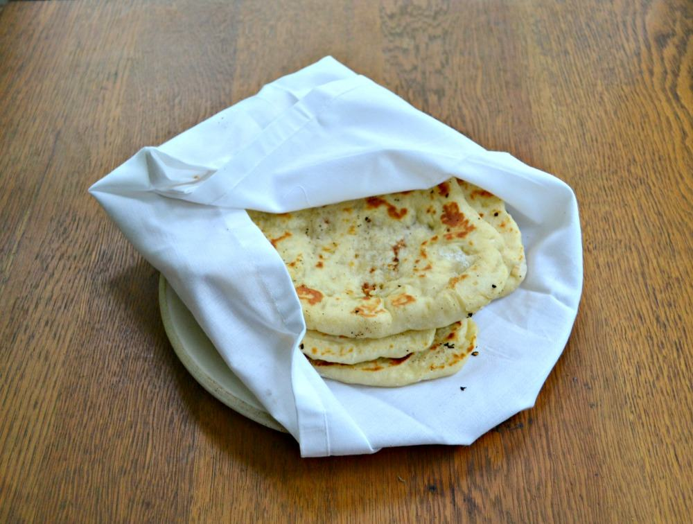 Homemade Naan is a flatbread made in a skillet and brushed with garlic and butter