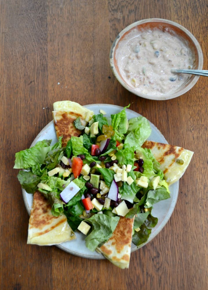 Don't heat up the oven this summer!   Make this filling Southwest Chopped Salad with Quesadillas and Mexi-Ranch Dressing