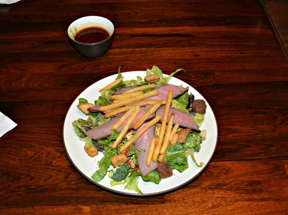 Steak and Fries on a bed of mixed greens make for a tasty Steak Salad