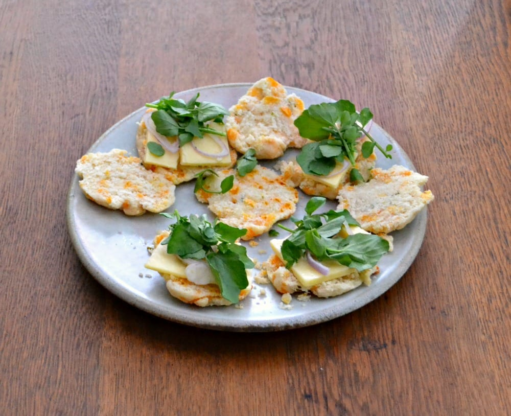 CHeddar Chive Tea Sandwiches top Cheddar Chive Scones with cheese, watercress, and shallots.
