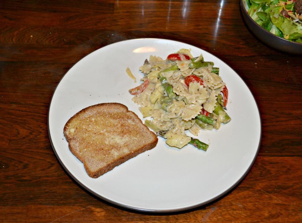 Quick and easy Lemon and Artichoke Pasta with artichokes, asparagus, and tomatoes.