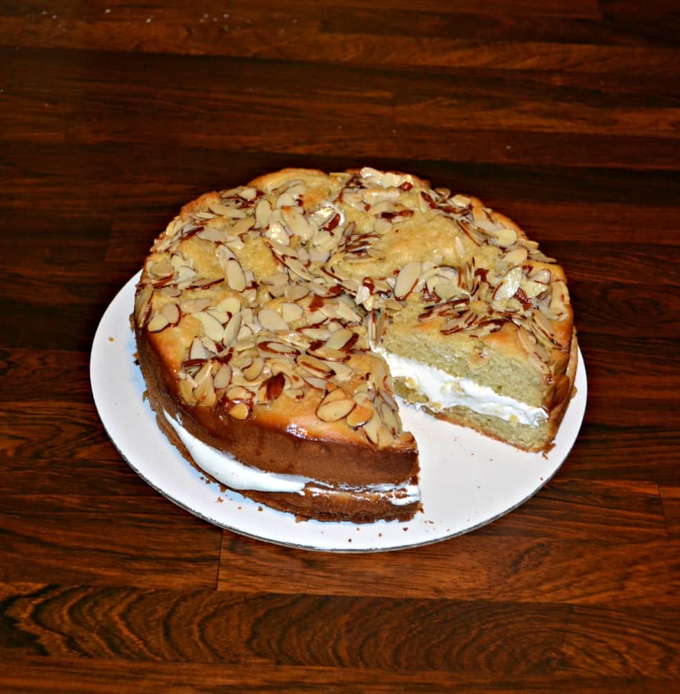 Bee Sting Cake filled with fluffy pastry cream  and a crunchy nut topping and rum glaze